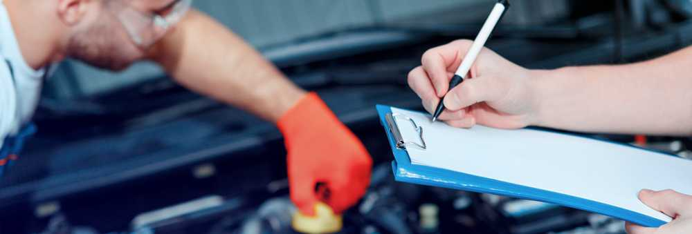 Mechanics serviicng a vehicle - Car Servicing Whitstable